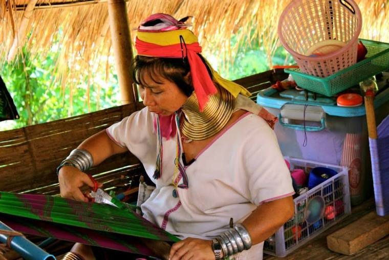 A lady from the Karen Hill Long Neck Tribe making a scarf