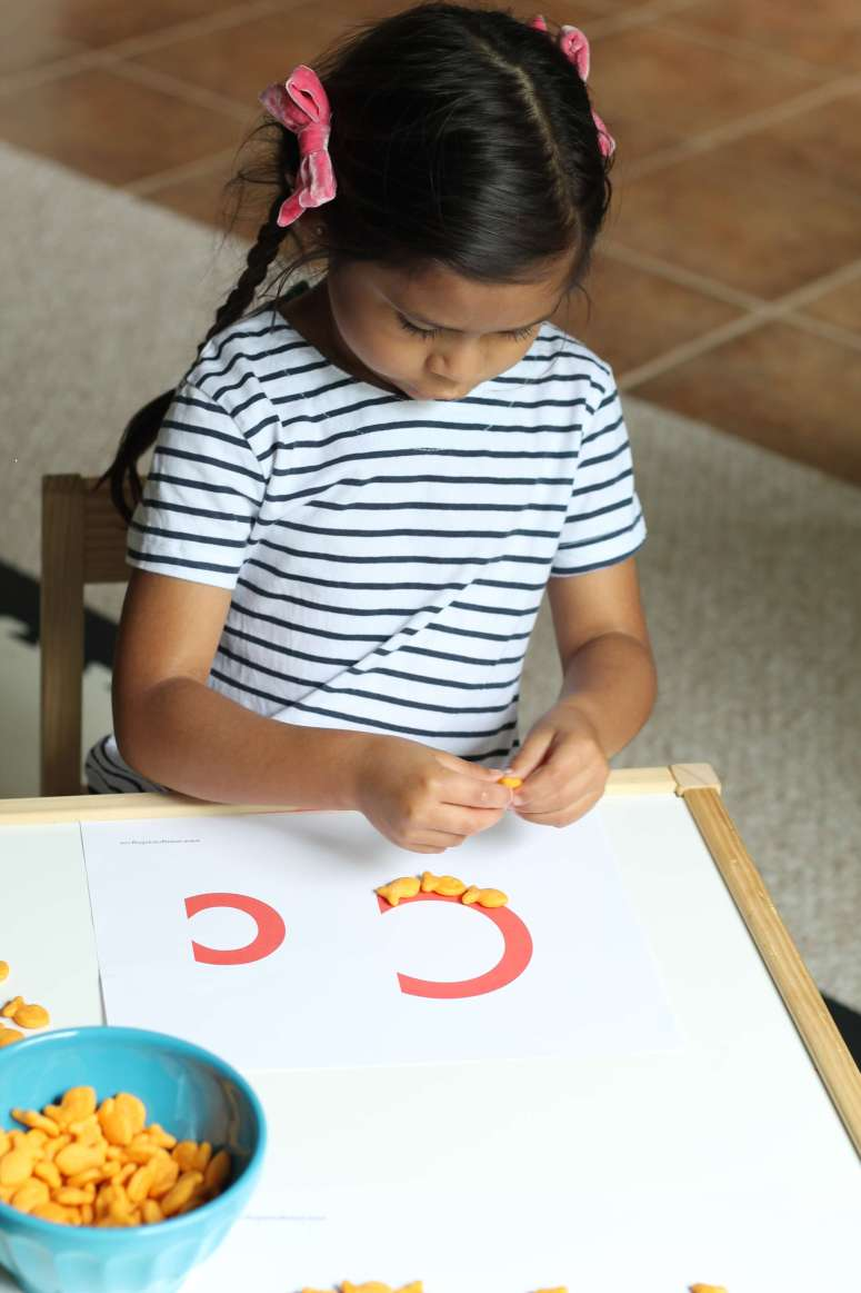 Letter recognition activity with Goldfish crackers! The perfect snack hack for a fun, rainy day activity indoors.