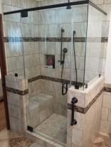 A frameless glass shower with custom tile work