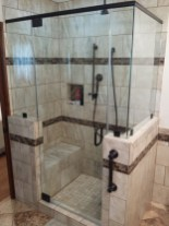 A frameless glass shower with custom tile work