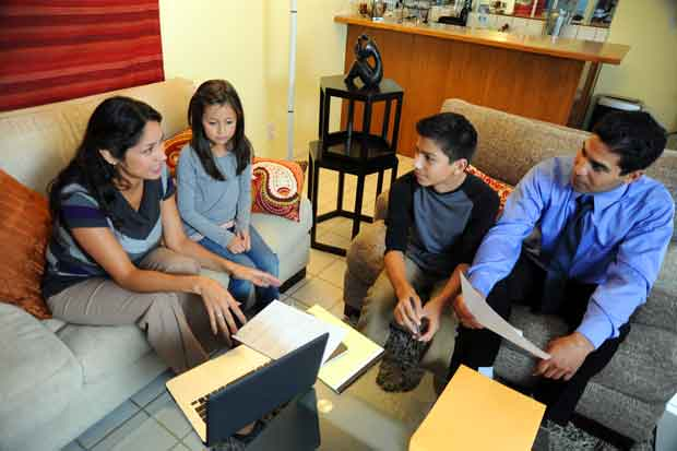 American family discuss their emergency plan during National Preparedness Month.