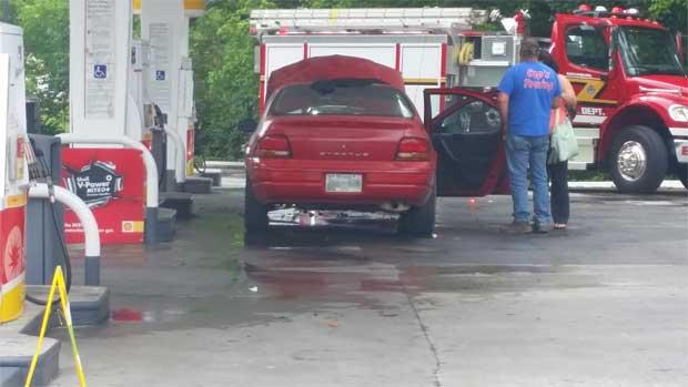Car engine fire at Gatlinburg gas station.