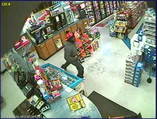 Surveillance image of armed robbery suspect.