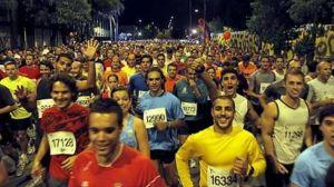 Salida de la carrera nocturna del Guadalquivir/Paco Puentes