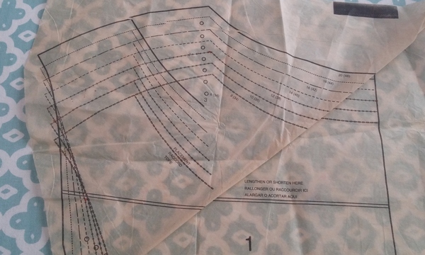 The front bodice pattern showing how I folded out a wedge to bring in the shoulders and reduce excess fabric in the upper chest area.