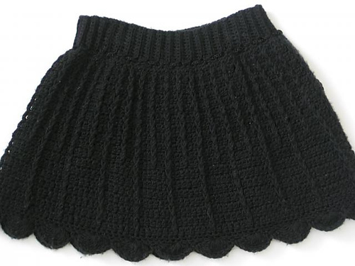 Olivia Crochet Free Skirt Pattern in black yarn, a simple crochet skirt with a ribbed waistband and flared skirt worked in the round.