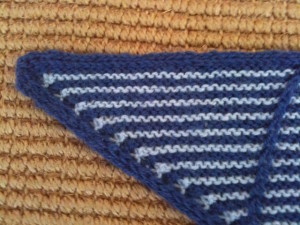 Asymmetrical triangle knitted shawl