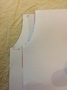 Folding one side over to use as guide for redrawing the arms eye seam.