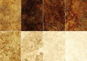 A beautiful package of (forty two) 10 x 10 inch precut squares in Browns, Golds, Cream and gradient neutral colors which look like different pieces of colored stone.