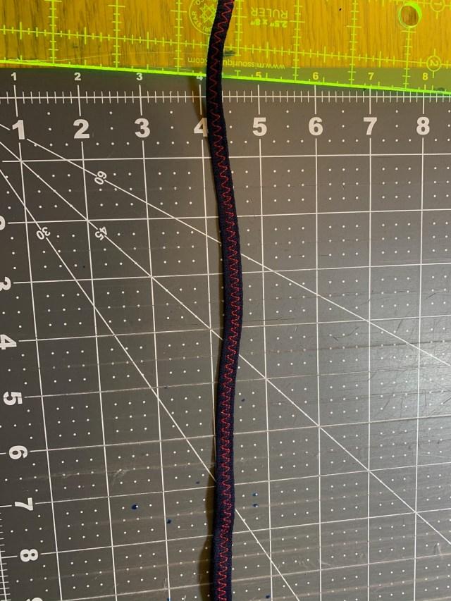 You can zig-zag stitch you t-shirt strip