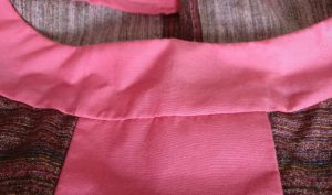 Invisible edge stitching around the neck facing - NB, I used purple thread here as it was the least visible colour on the liberty fabric - any visible stitching shows up like a sore thumb on the pink!