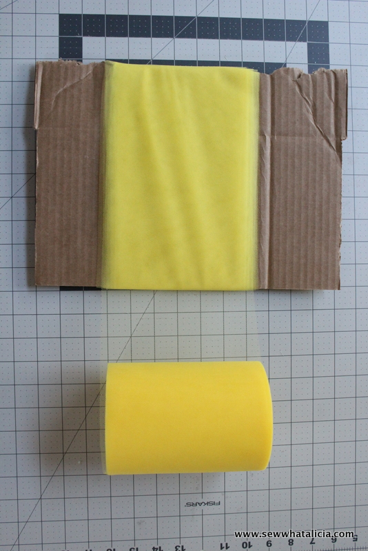 pictured wrapping tool around a cardboard template
