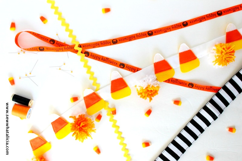 Candy Corn and Pom Pom Bunting Tutorial: This is a great sewing project for beginners. Decorate for Halloween with this quick and easy candy corn bunting.  | www.sewwhatalicia.com