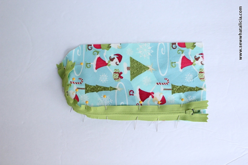 Elf on the Shelf Sleeping Bag Tutorial| All you need to know is how to sew! I will teach you how to put in the zipper and create an adorable sleeping bag for the elf on the shelf in your family. Click through for the full tutorial! www.sewwhatalicia.com