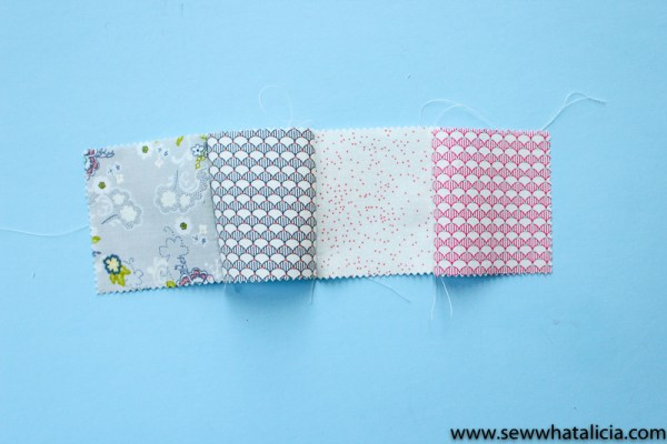Fabric Baby Blocks Sewing Tutorial: This tutorial will walk you through creating a Y seam to create these fabric baby blocks. This is a great tutorial for beginners and new mommas! Click through for the full tutorial. | www.sewwhatalicia.com
