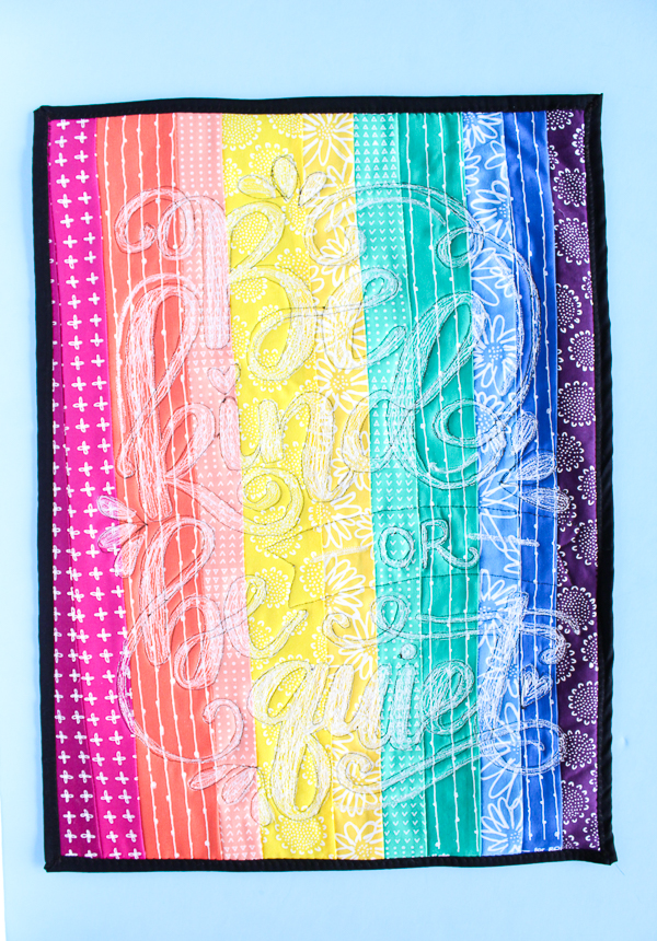 Rainbow Doodle Stitch Mini Quilt: This mini quilt takes a little time but the end result is stunning and I would love to show you how I made it! Click through for the full tutorial. | www.sewwhatalicia.com