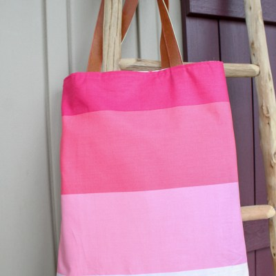 How to make a tote bag: Finished beauty shot of tote hanging on ladder.   www.sewwhatalicia.com