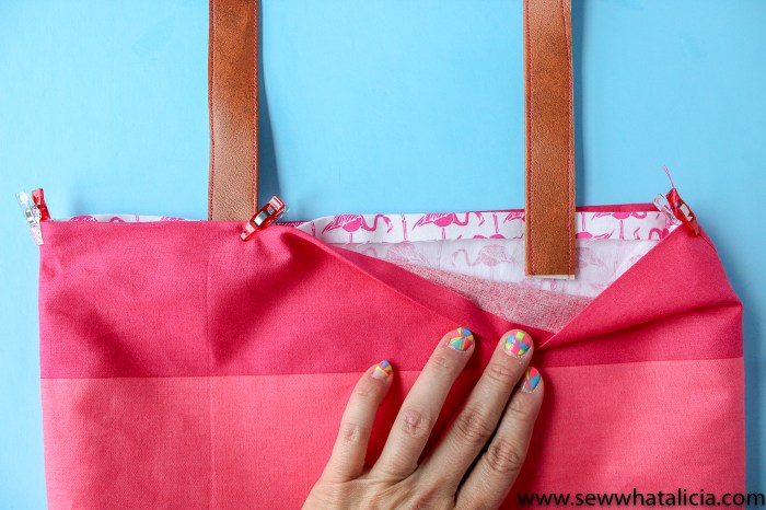 How to make a tote bag: Line up the leather handles between the two layers of fabric. | www.sewwhatalicia.com