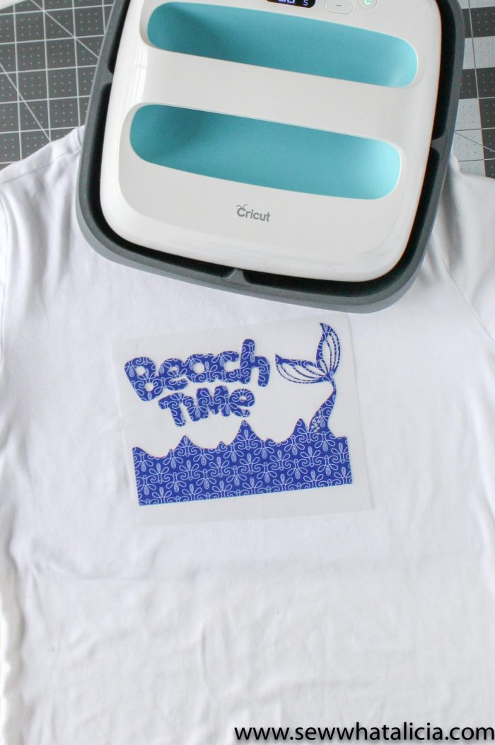 Cricut Patterned Iron On Tips and Tricks: Pictured beach design placed on shirt with Cricut EasyPress above. | www.sewwhatalicia.com