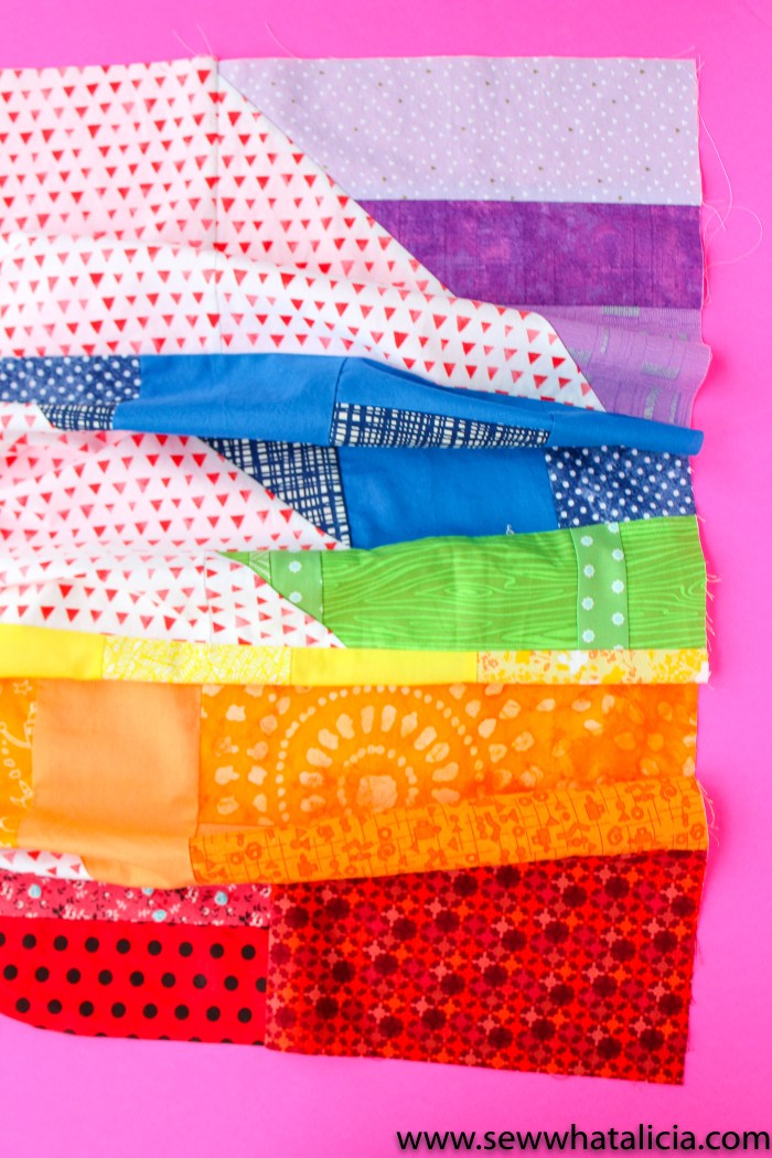 Scrappy Easy Rainbow Quilt Pattern and Tutorial: Pictured all the colored stripes pieced together for a finished quilt top. | www.sewwhatalicia.com