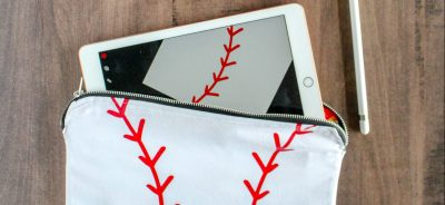 Metal Zipper Pouch Tutorial: Sewing with a metal zipper is not much different than sewing a regular zipper. Check out all my tips and tricks for using a metal zipper. Plus grab this free laces cut file to create your own baseball tablet case. Click through for the full beginner sewing tutorial. | www.sewwhatalicia.com