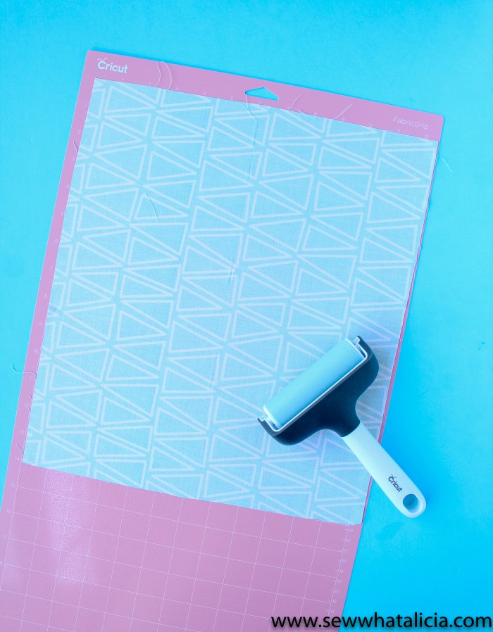 Cricut Fabric Mat with Fabric and the Brayer
