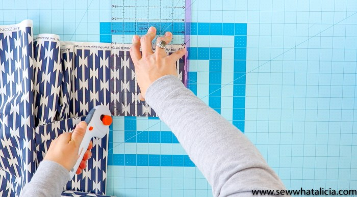 "Cutting a 6"" square from all four corners of the fabric."