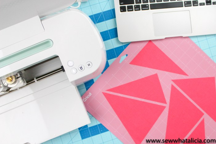 pictured: cut pieces on pink fabric mat and the mint cricut maker