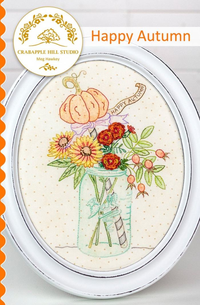 embroidered jar with flowers and pumpkin on top