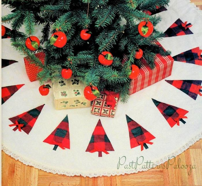 Christmas tree skirt with buffalo plaid trees and trimmed with lace