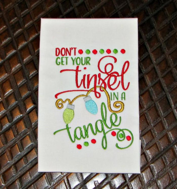 embroidery design that says don't get your tinsel in a tangle
