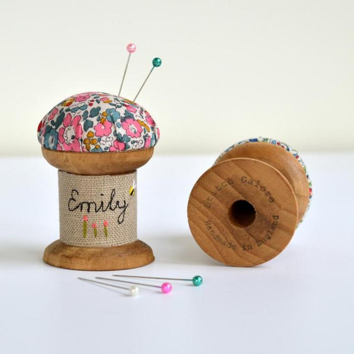 wooden spool turned into personalized pin cushion for sewing