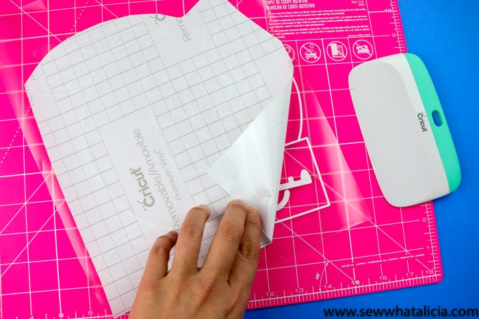 pictured white removable vinyl on transfer tape on a pink cutting mat