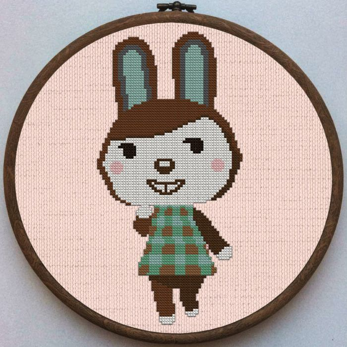 pictured carmen from animal crossing done in cross stitch