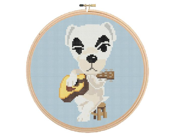 pictured kk slider from animal crossing sitting on a stool with a guitar