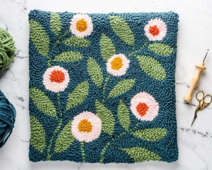 green square punch embroidery with white flowers