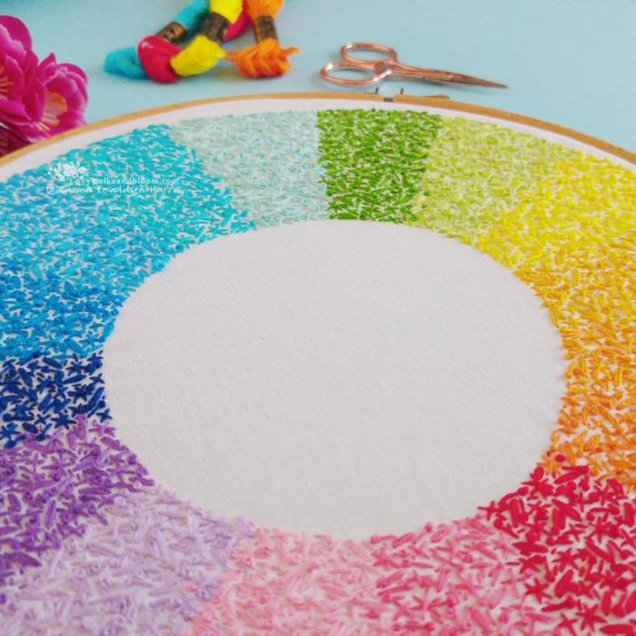 pictured color wheel made up of tons of various tiny stitches