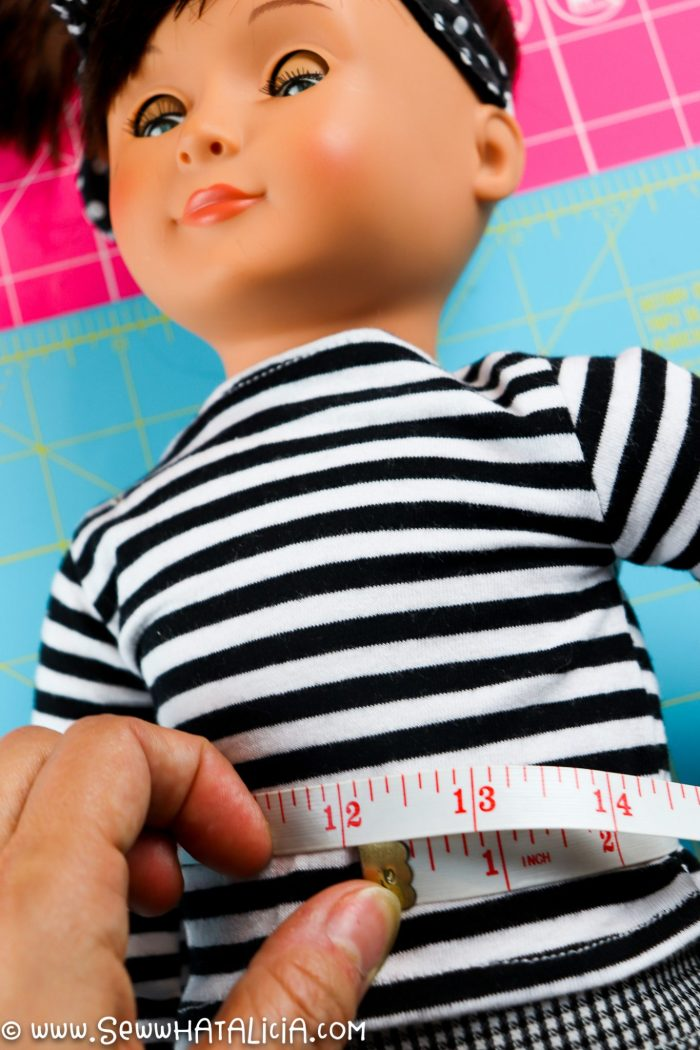 pictured tape measure around doll waist
