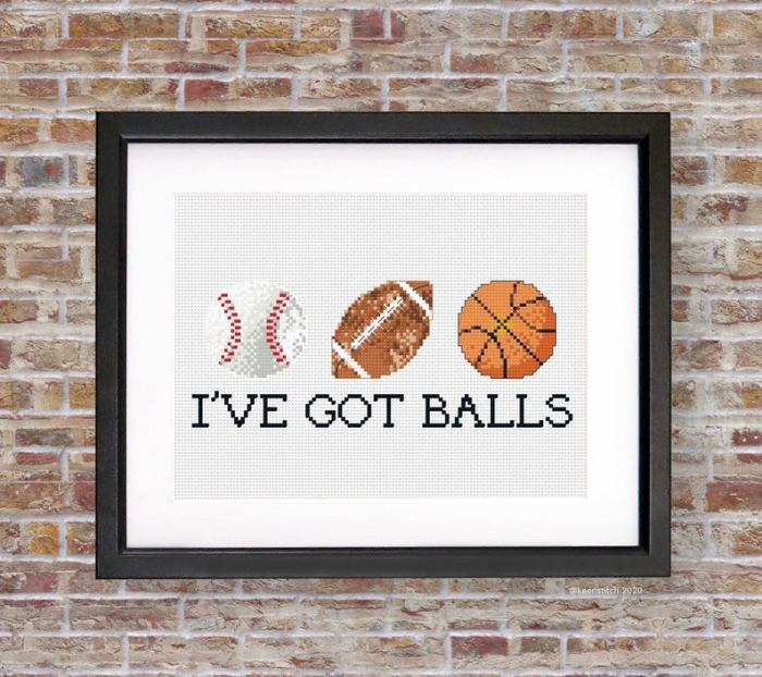 pictured baseball football and basketball with words i've got balls framed on a brick background