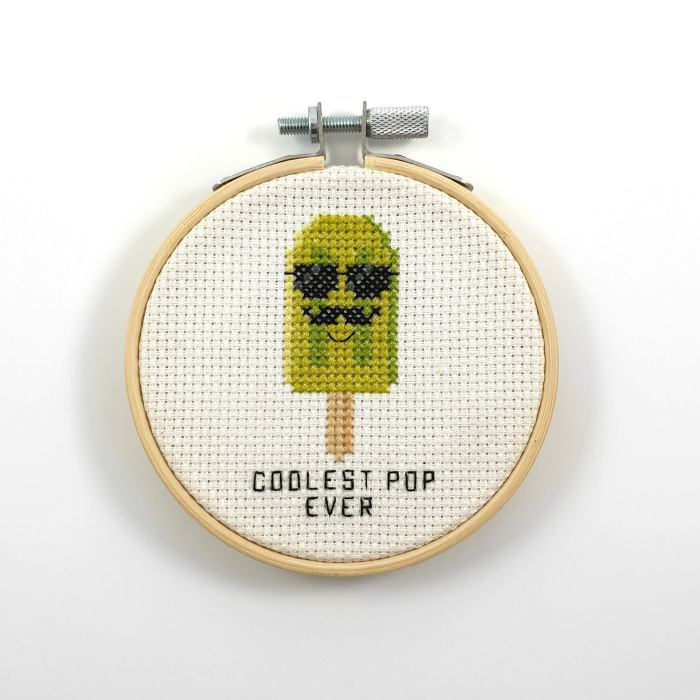 pictured cross stitch hoop with green popsicle  and words coolest pop ever
