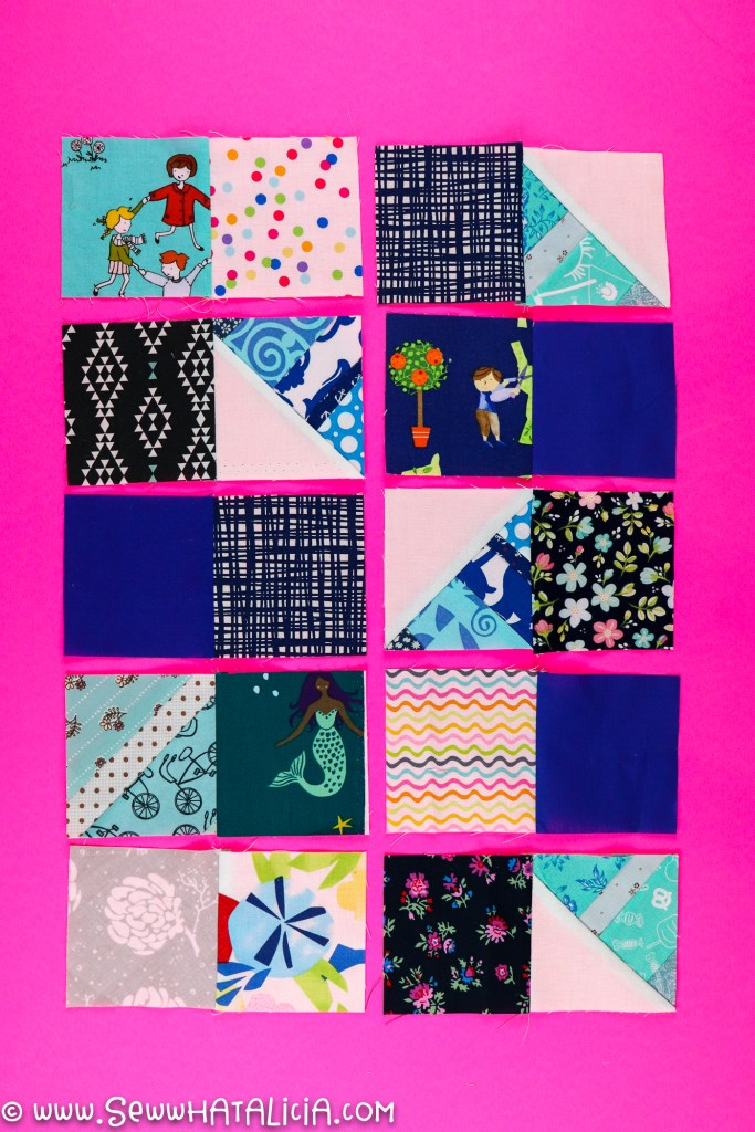 blue quilt squares sewn together in pairs
