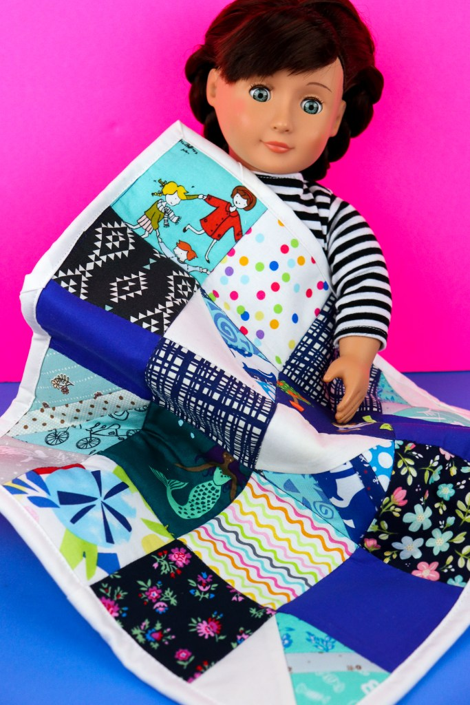 doll with finished patchwork quilt