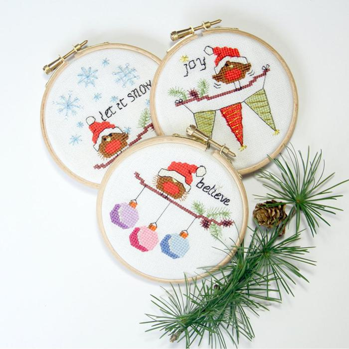 set of three ornaments with robins in santa hats