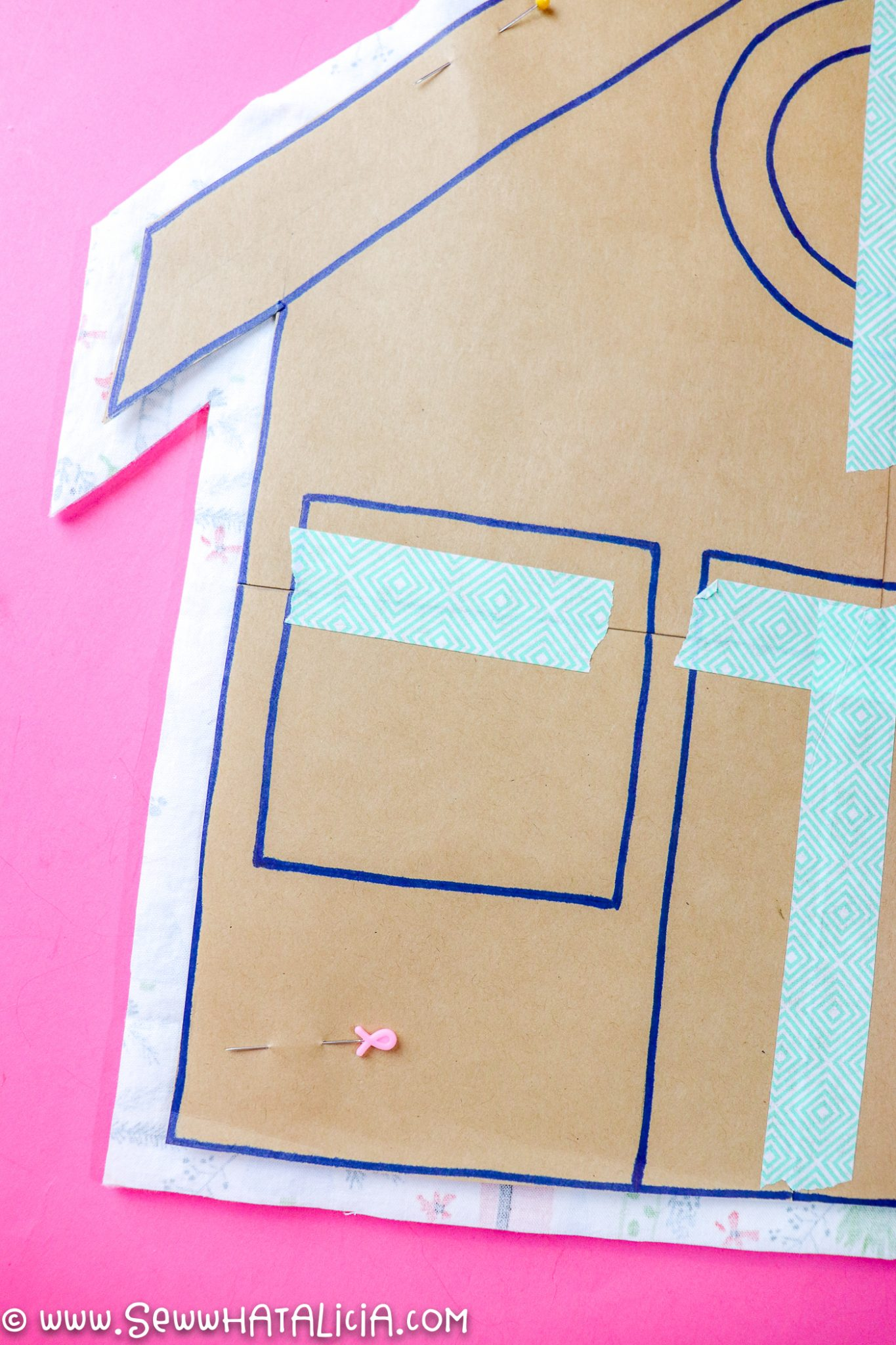 paper pattern over cut fabric gingerbread house pieces