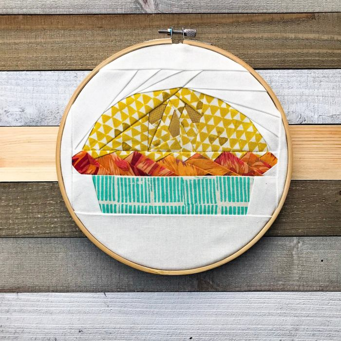 paper pieced pie displayed in an embroidery hoop