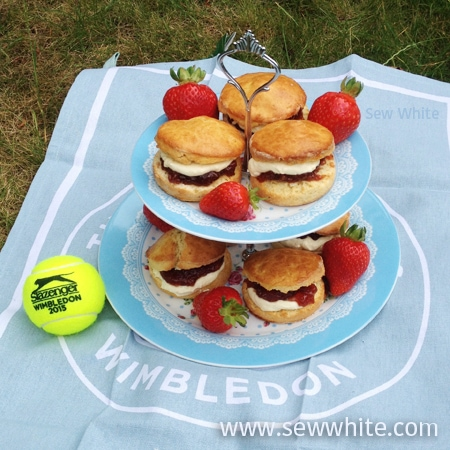 scones on a tiered stand on a Wimbledon tennis tea towel