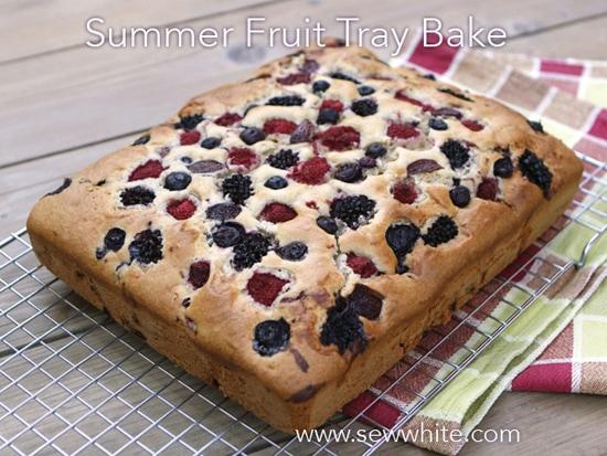 golden cake studded with summer berries summer fruit traybake