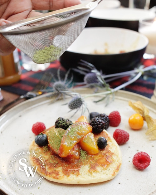 Adding Matcha powder to the Scotch Pancakes with Peach Compote.