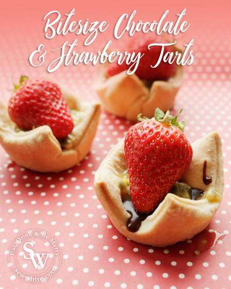bite-size chocolate and strawberry tarts topped with a scoop of passionfruit