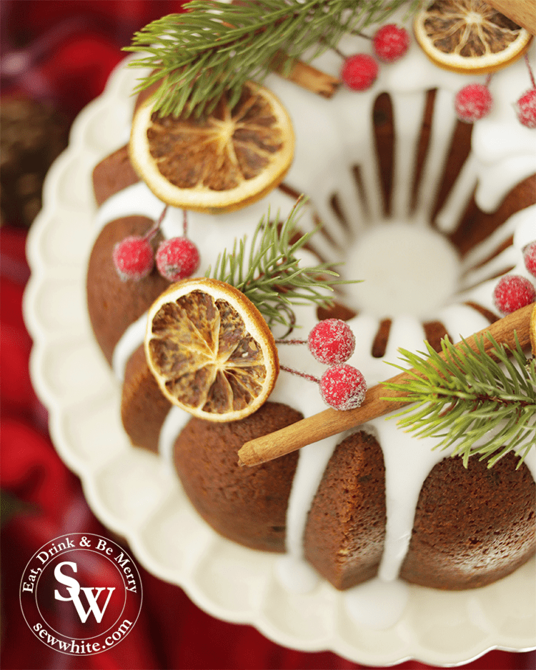 Christmas bundt cake decorated with dried orange slices and cinnamon sticks